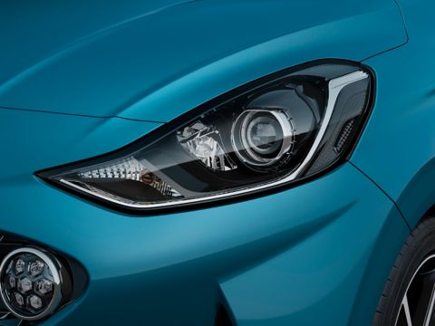 A close up look at the all-new Hyundai i10's new Bi-function projection headlamps and LED Daytime Running Lights.
