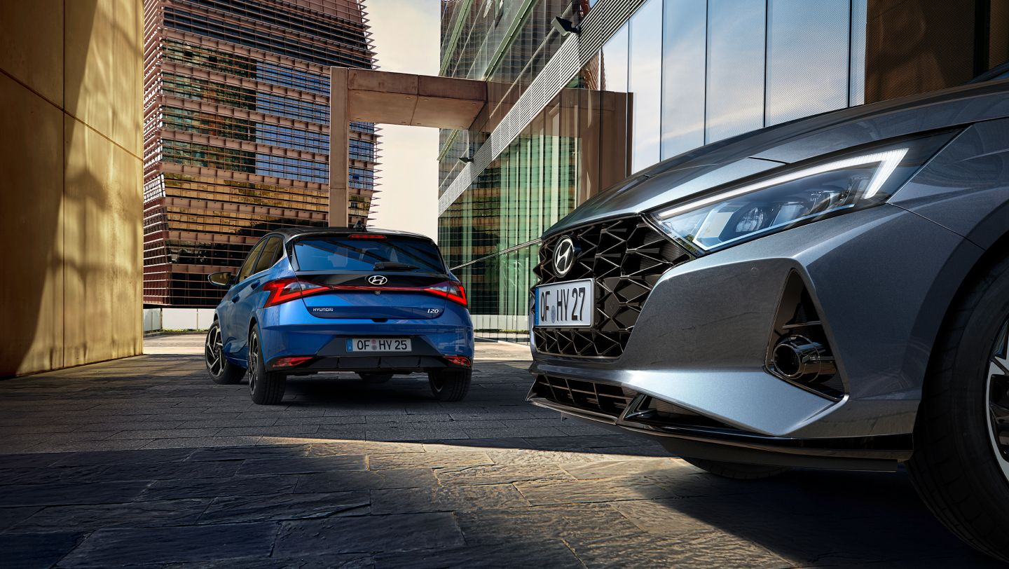 Two all-new Hyundai i20s in an alley, parked at a 90 degree angle