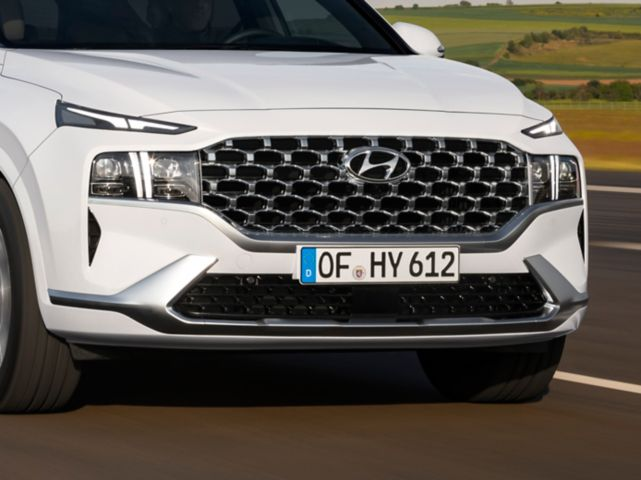 Close up image showing the T-shaped LED Daytime Running Lights of the new Hyundai Santa Fe SUV.