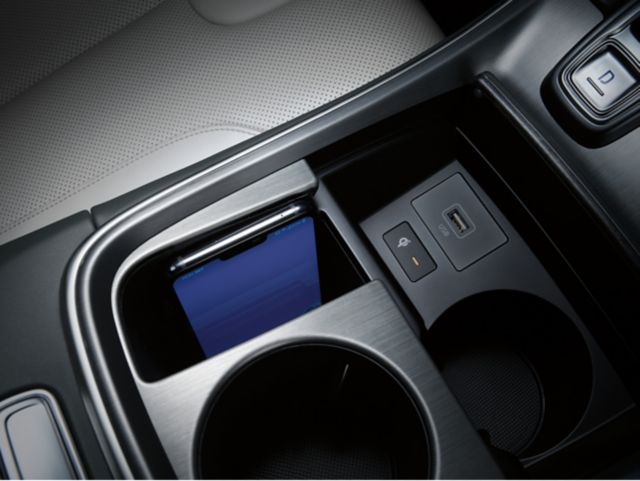A close-up image of the upgraded wireless charging pad in the new Hyundai Santa Fe.