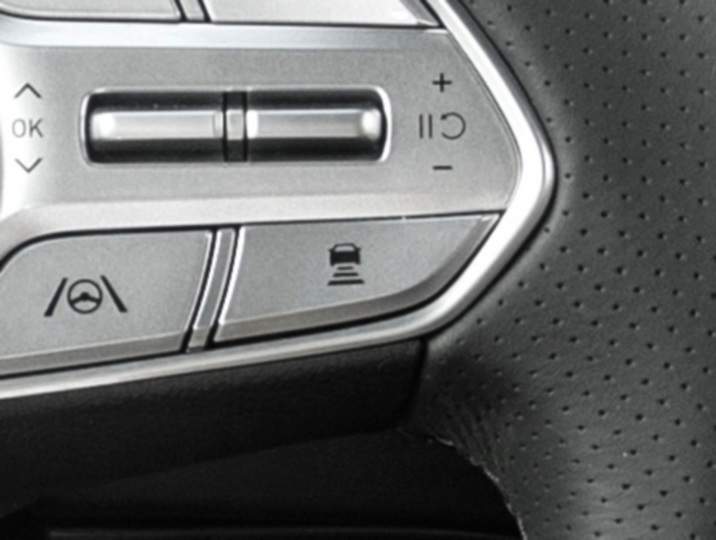A close up image at the control buttons on the sporty steering wheel of the new Hyundai Santa Fe SUV.
